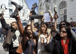 Protesters brandishing shoes during a demonstration to demand the resignation of Tunisian Minister of Women's Affairs, Sihem Badi on March 29, 2013 in Tunis. Badi is highly criticized for months for her good relations with the Islamist ruling party Ennahda and recently for her support to a kindergarten where a three-year-old girl has been raped. AFP PHOTO / FETHI BELAID